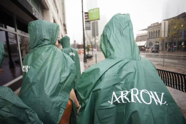 Arrow rain ponchos keep SXSW attendees dry (and hooded) outside the Warner Bros. Tell-A-Vision experience in Austin. (Photo Credit: ©2013 Warner Bros. Entertainment Inc. All Rights Reserved.)