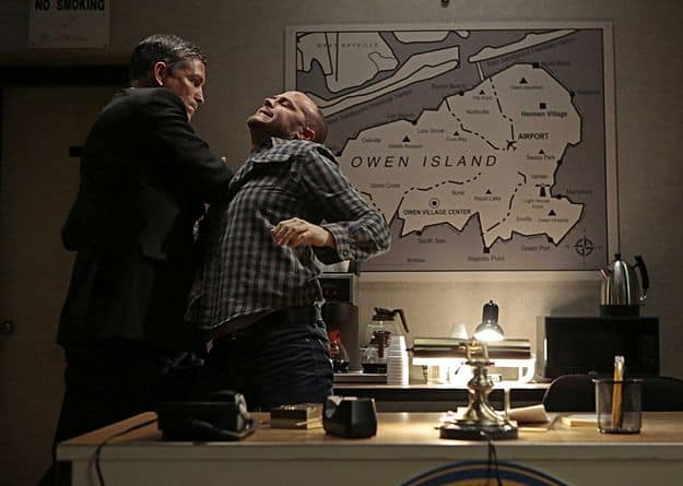 hile forced to ride out a storm in a coastal town with a group of local residents, Reese (Jim Caviezel, left) comes to blows with one of them (Dennis Flanagan, right)