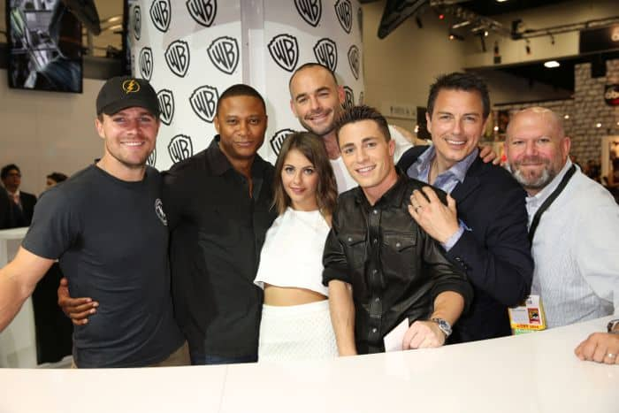 ARROW takes aim at the Warner Bros. booth at Comic-Con 2014. From left: Stars Stephen Amell, David Ramsey, Willa Holland, Paul Blackthorne, Colton Haynes and John Barrowman, with executive producer Marc Guggenheim