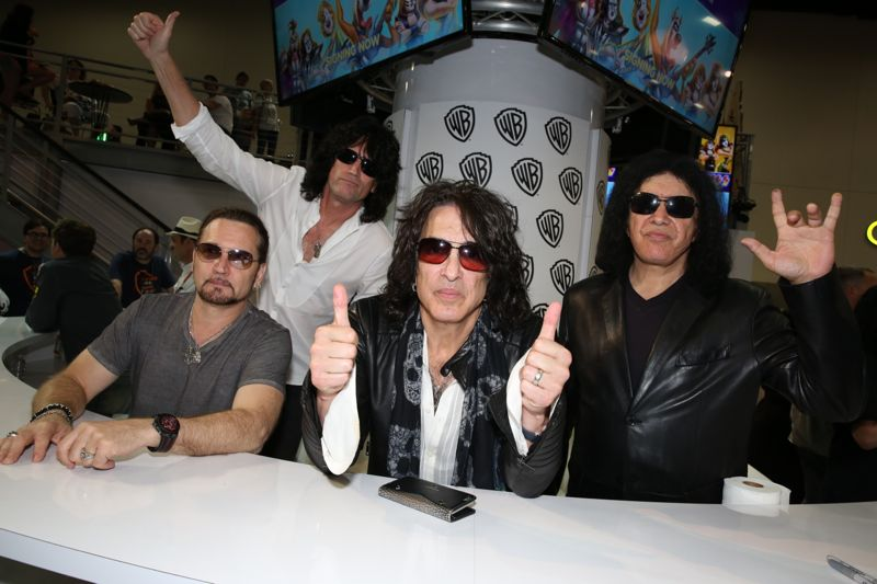(L-R) KISS members Eric Singer, Tommy Thayer, Paul Stanley and Gene Simmons preside over their SCOOBY-DOO! AND KISS: ROCK AND ROLL MYSTERY signing in the Warner Bros. booth at Comic-Con 2015. #WBSDCC (©2015 WBEI. All rights reserved.)