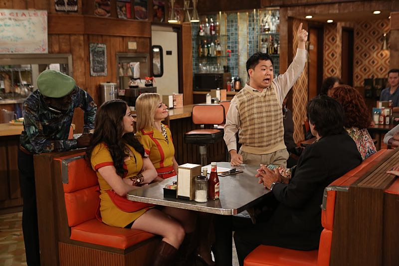 """""""And the Wrecking Ball"""" -- Max and Caroline team up with the diner staff in a frantic attempt to keep their businesses open when the city targets Han's diner and their cupcake window for destruction. Also, Sophie and Oleg announce that they are trying to have a baby, on the fifth season premiere of 2 BROKE GIRLS, Thursday, November 12 (9:30-10:00 PM, ET/PT) on the CBS Television Network. From left, Earl (Garrett Morris), Max Black (Kat Dennings), Caroline Channing (Beth Behrs) and Han Lee (Matthew Moy), shown. Photo: Monty Brinton/CBS ©2015 CBS Broadcasting, Inc. All Rights Reserved"""