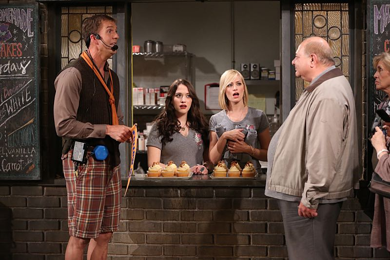 """""""And the Wrecking Ball"""" -- Max and Caroline team up with the diner staff in a frantic attempt to keep their businesses open when the city targets Han's diner and their cupcake window for destruction. Also, Sophie and Oleg announce that they are trying to have a baby, on the fifth season premiere of 2 BROKE GIRLS, Thursday, November 12 (9:30-10:00 PM, ET/PT) on the CBS Television Network. From left, Dannon (Regan Burns), Max Black (Kat Dennings) and Caroline Channing (Beth Behrs), shown. Photo: Monty Brinton/CBS ©2015 CBS Broadcasting, Inc. All Rights Reserved"""