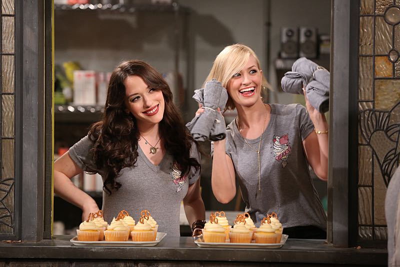 """""""And the Wrecking Ball"""" -- Max and Caroline team up with the diner staff in a frantic attempt to keep their businesses open when the city targets Han's diner and their cupcake window for destruction. Also, Sophie and Oleg announce that they are trying to have a baby, on the fifth season premiere of 2 BROKE GIRLS, Thursday, November 12 (9:30-10:00 PM, ET/PT) on the CBS Television Network. From left, Max Black (Kat Dennings) and Caroline Channing (Beth Behrs), shown. Photo: Monty Brinton/CBS ©2015 CBS Broadcasting, Inc. All Rights Reserved"""