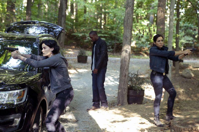 "BLINDSPOT -- ""Sent on Tour"" Episode 107 -- Pictured: (l-r) Jaimie Alexander as Jane Doe, Rob Brown as Edgar Reed, Audrey Esparza as Tasha Zapata -- (Photo by: Giovanni Rufino/NBC)"
