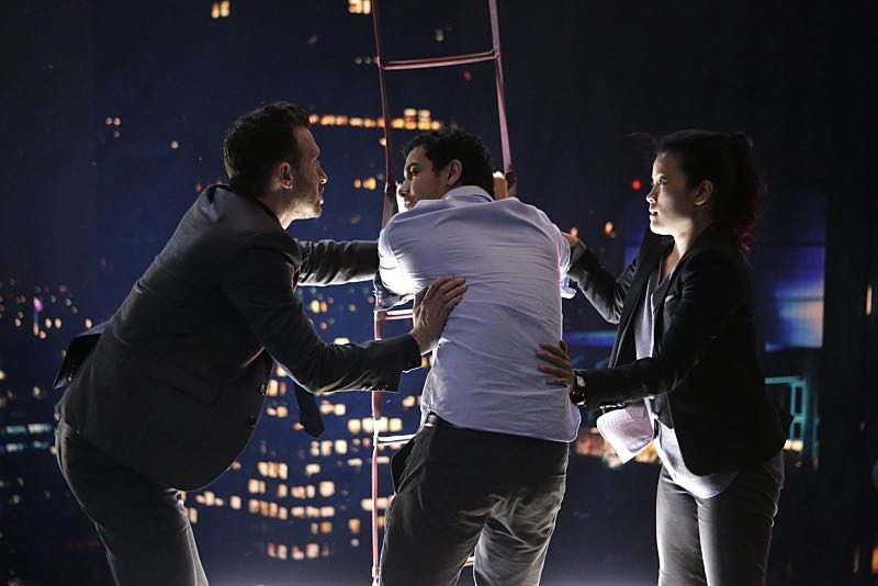 """""""Tech, Drugs, and Rock 'n Roll"""" -- Walter's attempt to 'normalize' goes horribly wrong when a nefarious virus is loaded onto his computer, turning Team Scorpion's new 'smart' building project into a burning death trap with people locked inside, on a special 90 minute episode of SCORPION, Monday October 26 (9:30-11:00 PM, ET/PT) on the CBS Television Network. Pictured:Eddie Kaye Thomas as Toby Curtis, Elyes Gable as Walter O'Brien, Jadyn Wong as Happy Quinn. Photo: Sonja Flemming/CBS ©2015 CBS Broadcasting, Inc. All Rights Reserved"""