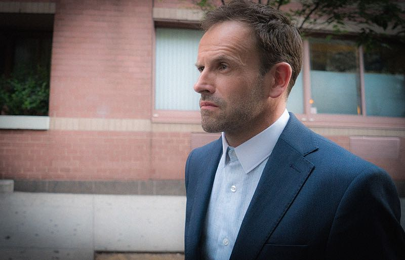 """""""Evidence of Things Not Seen"""" -- When Morland offers to use his influence to have Sherlock and Joan reinstated as consultants to the NYPD, Sherlock's mistrust of his father makes him question his motivation to help. Also, with no work offers coming in, Watson wrangles a gig with the FBI investigating a triple homicide in a top-secret research lab, on ELEMENTARY, Thursday, Nov. 12 (10:00-11:00 PM, ET/PT) on the CBS Television Network. Pictured Jonny Lee Miller as Sherlock Holmes Photo: Ali Goldstein/CBS © 2015 CBS Broadcasting Inc. All Rights Reserved."""