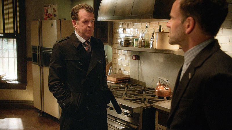 """""""Evidence of Things Not Seen"""" -- When Morland offers to use his influence to have Sherlock and Joan reinstated as consultants to the NYPD, Sherlock's mistrust of his father makes him question his motivation to help. Also, with no work offers coming in, Watson wrangles a gig with the FBI investigating a triple homicide in a top-secret research lab, on ELEMENTARY, Thursday, Nov. 12 (10:00-11:00 PM, ET/PT) on the CBS Television Network. Pictured (L-R) John Noble as Mr. Morland Holmes and Jonny Lee Miller as Sherlock Holmes Photo: Best Possible Screen grabCBS © 2015 CBS Broadcasting Inc. All Rights Reserved."""