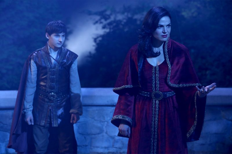 """ONCE UPON A TIME - """"Dreamcatcher"""" - In Camelot, as Mary Margaret and David attempt to retrieve the Dark One dagger, Emma uses a dreamcatcher to look into the past to see how Merlin was transformed into a tree. Together, Emma and Regina figure out the critical ingredient they must acquire to free Merlin, but it's a race against Arthur, who does not want Merlin released. Meanwhile, with encouragement from his moms, Henry musters up the courage to ask Violet on a date. Back in Storybrooke, the heroes break into Emma's house hoping to locate Gold, but what they find will give them a glimpse of Emma's end game. Far from prying eyes, Merida sets about the mission Emma has tasked her with and begins molding Gold into the hero they need to draw Excalibur, on """"Once Upon a Time,"""" SUNDAY, OCTOBER 25 (8:00-9:00 p.m., ET) on the ABC Television Network. (ABC/Jack Rowand) JARED GILMORE, LANA PARRILLA"""