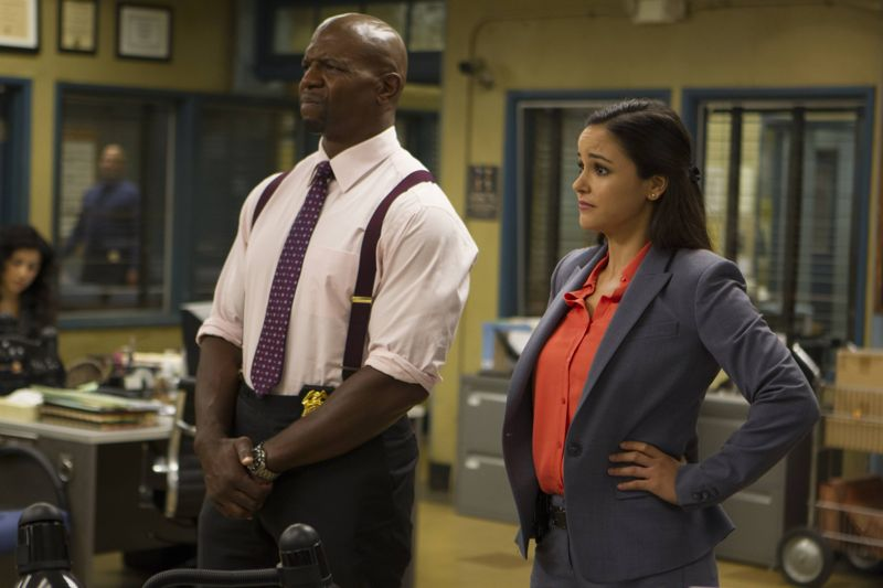 "BROOKLYN NINE-NINE: Sgt. Jeffords (Terry Crews) and Amy (Melissa Fumero) in the ""Boyle's Hunch"" episode of BROOKLYN NINE-NINE airing Sunday, Oct. 4 (8:30-9:00 PM ET/PT) on FOX. ©2015 Fox Broadcasting Co. CR: John P Fleenor/FOX."