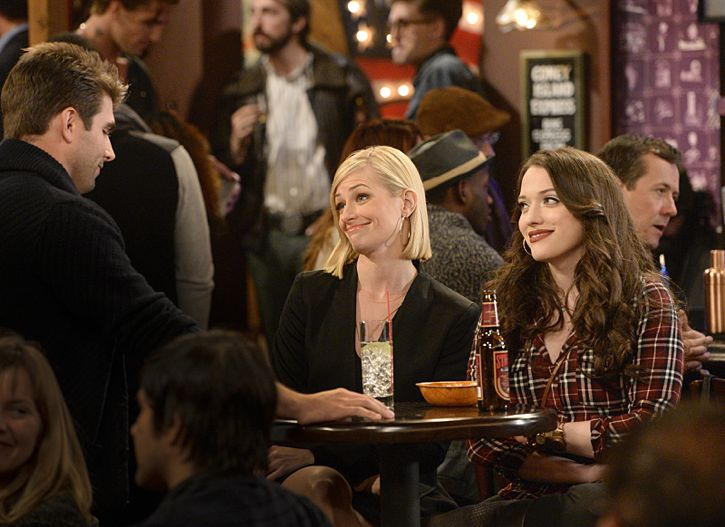 """""""And The Story Telling Show"""" -- Pictured (L-R): Michele Fitzgerald, Caroline Channing (Beth Behrs) and Max Black (Kat Dennings). Caroline shares her riches-to-rags life story on stage at a storytelling night and captures the attention of a Hollywood studio executive. Meanwhile, Sophie and Oleg search for a surrogate, when 2 BROKE GIRLS moves to its new day and time, Thursday, Feb. 18 (9:30-10:00 PM, ET/PT) on the CBS Television Network. Photo: Darren Michaels/Warner Bros. Entertainment Inc. © 2016 WBEI. All rights reserved."""