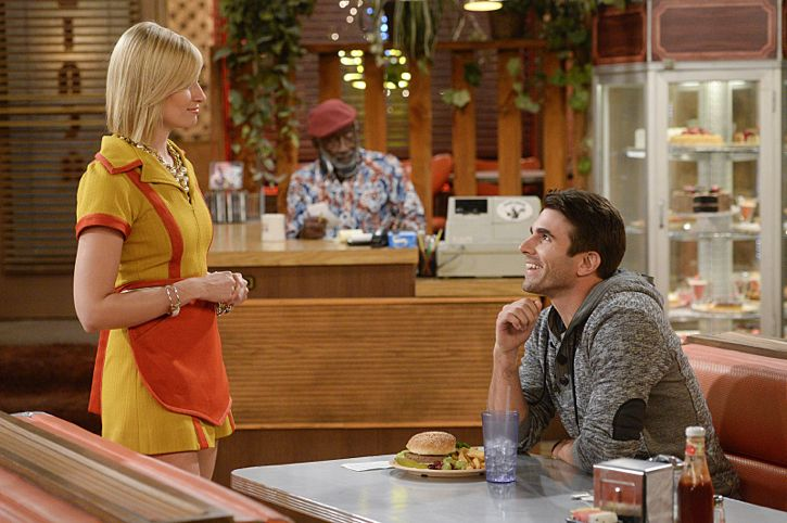 """""""And The Story Telling Show"""" -- Pictured (L-R): Caroline Channing (Beth Behrs), Earl (Garrett Morris) and Miles Fisher (Adam). Caroline shares her riches-to-rags life story on stage at a storytelling night and captures the attention of a Hollywood studio executive. Meanwhile, Sophie and Oleg search for a surrogate, when 2 BROKE GIRLS moves to its new day and time, Thursday, Feb. 18 (9:30-10:00 PM, ET/PT) on the CBS Television Network. Photo: Darren Michaels/Warner Bros. Entertainment Inc. © 2016 WBEI. All rights reserved."""