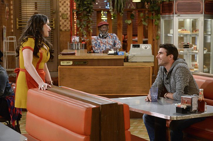 """""""And The Story Telling Show"""" -- Pictured (L-R): Max Black (Kat Dennings), Earl (Garrett Morris) and Miles Fisher (Adam). Caroline shares her riches-to-rags life story on stage at a storytelling night and captures the attention of a Hollywood studio executive. Meanwhile, Sophie and Oleg search for a surrogate, when 2 BROKE GIRLS moves to its new day and time, Thursday, Feb. 18 (9:30-10:00 PM, ET/PT) on the CBS Television Network. Photo: Darren Michaels/Warner Bros. Entertainment Inc. © 2016 WBEI. All rights reserved."""