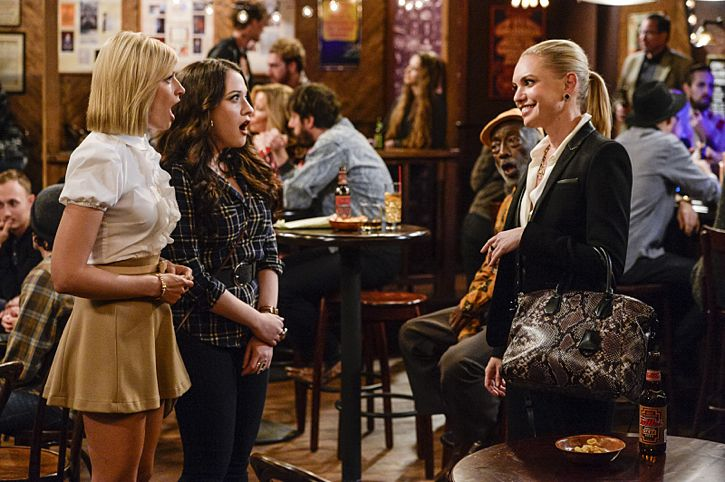 """""""And The Story Telling Show"""" -- Pictured (L-R): Caroline Channing (Beth Behrs), Max Black (Kat Dennings) and Nina (Barret Swatek). Caroline shares her riches-to-rags life story on stage at a storytelling night and captures the attention of a Hollywood studio executive. Meanwhile, Sophie and Oleg search for a surrogate, when 2 BROKE GIRLS moves to its new day and time, Thursday, Feb. 18 (9:30-10:00 PM, ET/PT) on the CBS Television Network. Photo: Darren Michaels/Warner Bros. Entertainment Inc. © 2016 WBEI. All rights reserved."""