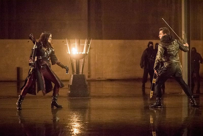 """Arrow -- """"Sins of the Father"""" -- Image AR413b_0295b.jpg -- Pictured (L-R): Katrina Law as Nyssa al Ghul and John Barrowman as Malcolm Merlyn -- Photo: Dean Buscher/ The CW -- © 2016 The CW Network, LLC. All Rights Reserved."""