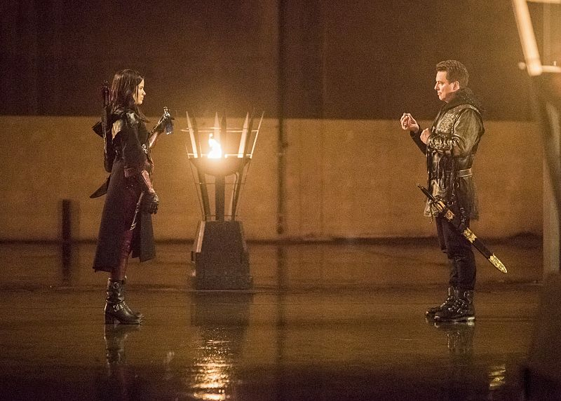 """Arrow -- """"Sins of the Father"""" -- Image AR413b_0292b.jpg -- Pictured (L-R): Katrina Law as Nyssa al Ghul and John Barrowman as Malcolm Merlyn -- Photo: Dean Buscher/ The CW -- © 2016 The CW Network, LLC. All Rights Reserved."""