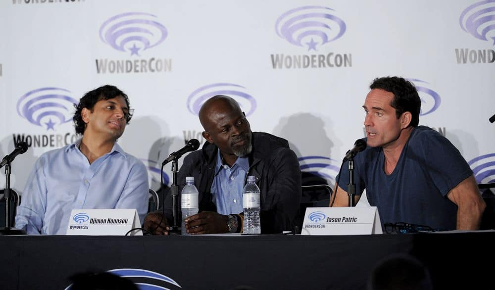 FOX FANFARE AT WONDERCON® LOS ANGELES 2016: L-R: WAYWARD PINES Executive Producer M. Night Shyamalan and cast members Jason Patrick and Djimon Hounsou speak to fans during the WAYWARD PINES panel at WonderCon® Los Angeles 2016 on Saturday, March 26 at the FOX FANFARE AT WONDERCON® LOS ANGELES 2016 at the Los Angeles Convention Center in Los Angeles, CA. CR: Frank Micelotta/FOX © 2016 FOX BROADCASTING