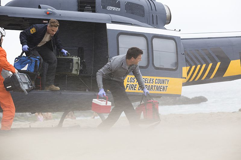 """Second Year"" -- Colonel Ethan Willis (Rob Lowe) joins the team at Angels Memorial from the Department of Defense and takes Dr. Mike Leighton on a harrowing helicopter ride to save shark bite victims in Malibu, on the second season premiere of CODE BLACK, Wednesday, Sept. 28 (10:00-11:00PM, ET/PT), on the CBS Television Network.   Pictured: Rob Lowe (Col. Ethan Willis), Tommy Dewey (Dr. Mike Leighton)  Photo: Paul Sarkis/CBS ©2016 CBS Broadcasting, Inc. All Rights Reserved"