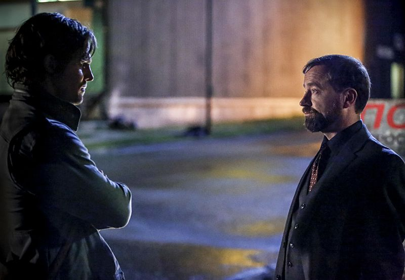 """Arrow -- """"Legacy"""" -- Image AR501d_0204b --- Pictured (L-R): Stephen Amell as Oliver Queen and David Nykl as Anatoly Knyazev -- Photo: Bettina Strauss/The CW -- © 2016 The CW Network, LLC. All Rights Reserved."""