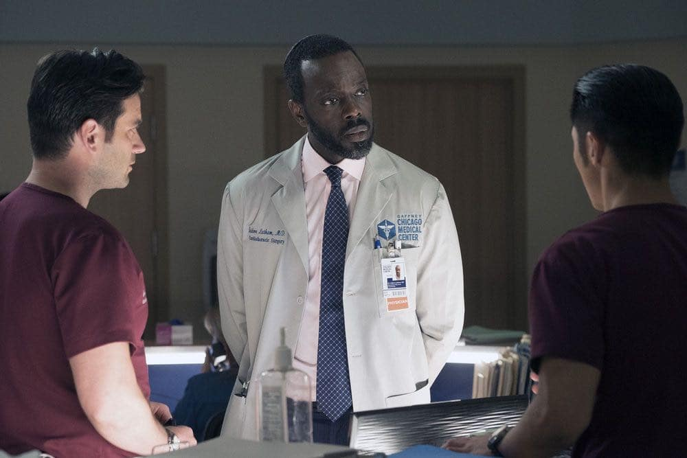 """CHICAGO MED -- """"Brother's Keeper"""" Episode 204 -- Pictured: (l-r) Colin Donnell as Connor Rhodes, Ato Essandoh as Isidore Latham, Brain Tee as Ethan Choi -- (Photo by: Elizabeth Sisson/NBC)"""