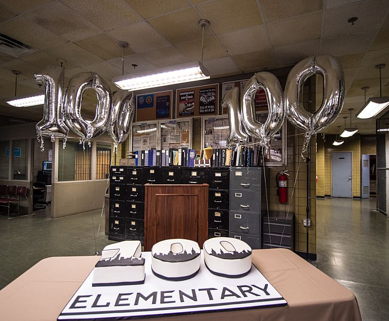 """""""Henny Penny The Sky Is Falling"""" -- The cast of ELEMENTARY celebrates their milestone 100th episode with a cake-cutting ceremony Pictured (L-R) Photo: Michele Crowe /CBS ©2016 CBS Broadcasting Inc. All Rights Reserved."""