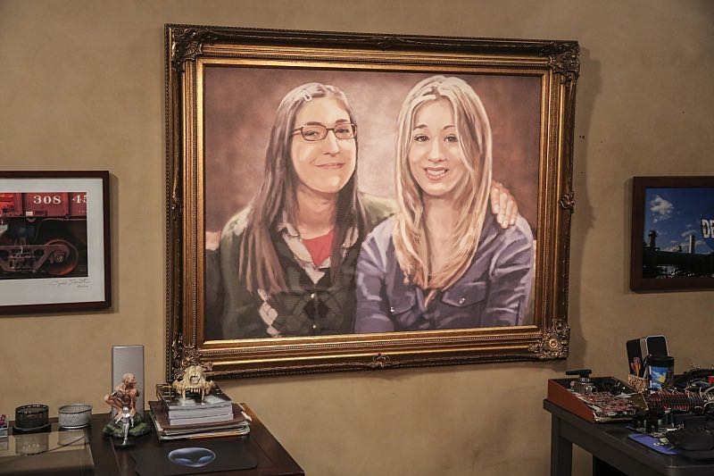 """""""The Property Division Collision"""" -- Pictured: a portrait of Amy Farrah Fowler (Mayim Bialik) and Penny (Kaley Cuoco). Sheldon and Leonard try to divvy up their shared belongings, but can't agree on anything. Also, Koothrappali and Stuart fight to be the most helpful during Bernadette's final weeks of pregnancy, on THE BIG BANG THEORY, Thursday, Dec. 1 (8:00-8:31 PM, ET/PT), on the CBS Television Network. Christopher Lloyd guest stars as Theodore. Photo: Michael Yarish/Warner Bros. Entertainment Inc. © 2016 WBEI. All rights reserved."""