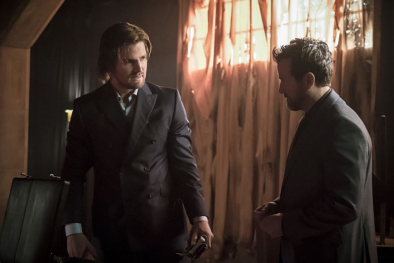 """Arrow -- """"So It Begins"""" -- Image AR506a_0079b.jpg -- Pictured (L-R): Stephen Amell as Oliver Queen and Art Kitching as Volkov -- Photo: Katie Yu/The CW -- © 2016 The CW Network, LLC. All Rights Reserved."""