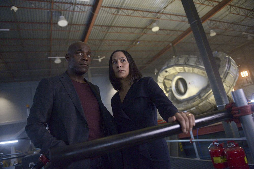 "TIMELESS -- ""The Watergate Tape"" Episode 105 -- Pictured: (l-r) Paterson Joseph as Connor Mason, Sakina Jaffrey as Denise Christopher -- (Photo by: Sergei Bachlakov/NBC)"