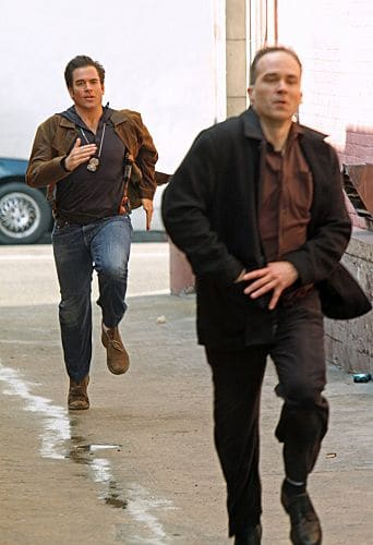 """""""Baltimore"""" - After Tony's (Michael Weatherly, left) ex-partner, Danny Price, appears to be the Port-to-Port Killer's latest victim, he revisits his days as a detective in Baltimore, including his first encounter with Gibbs, on NCIS, Tuesday, May 3 (8:00-9:00 PM, ET/PT) on the CBS Television Network.  Photo: Monty Brinton/CBS ©2011 CBS Broadcasting Inc. All Rights Reserved"""