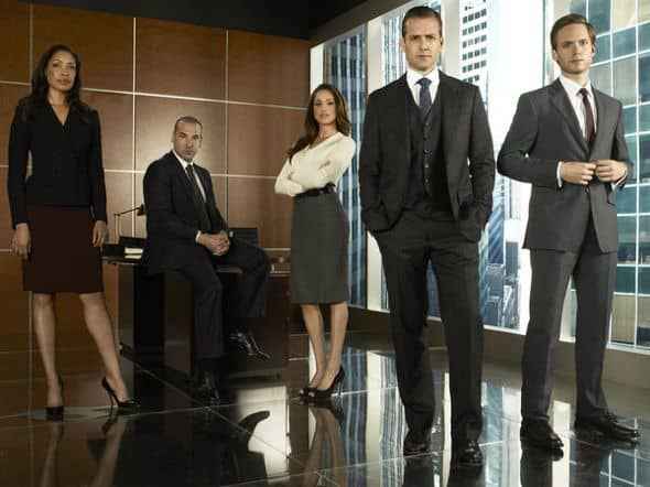 SUITS -- Season:1 -- Pictured: (l-r) Gina Torres as Jessica, Rick Hoffmann as Louis, Meghan Markle as Rachel Lane, Gabriel Macht as Harvey Specter, Patrick Adams as Mike Ross -- Photo by: Frank Ockenfels/USA Network