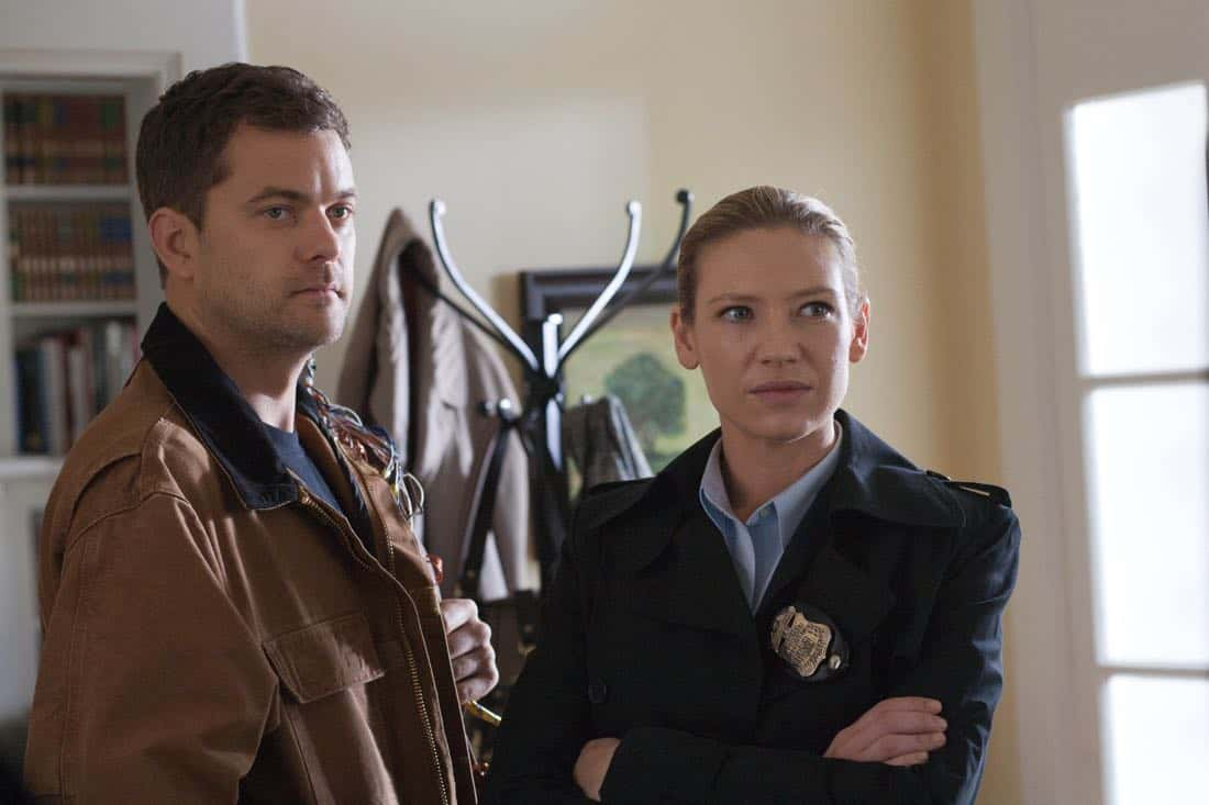 "FRINGE: Peter (Josh Jackson, L) and Olivia (Anna Torv, R) search a suspect's house in the ""And Those We've Left Behind"" episode of Fringe airing Friday, Nov. 11 (9:00-10:00 PM ET/PT) on FOX. ©2011 Fox Broadcasting Co. CR: Liane Hentscher/FOX"