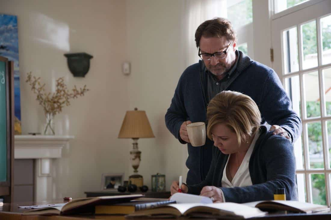 "FRINGE: Raymond (guest star Stephen Root, L) watches his wife Kate (guest star Romy Rosemont, R) work a math equation in the ""And Those We've Left Behind"" episode of Fringe airing Friday, Nov. 11 (9:00-10:00 PM ET/PT) on FOX. ©2011 Fox Broadcasting Co. CR: Liane Hentscher/FOX"