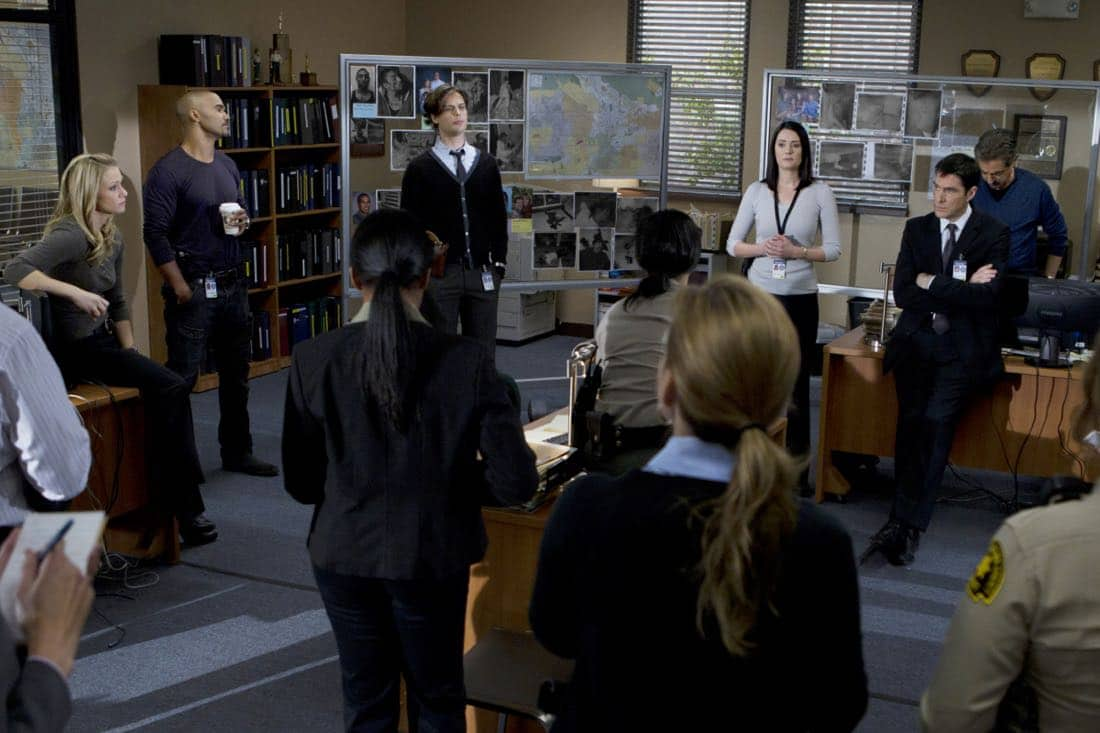"""""""A Thin Line""""-- Our BAU (LtoR: A.J. Cook, Shemar Moore, Matthew Gray Gubler, Paget Brewster, Thomas Gibson, and Joe Mantegna) team is in the process of briefing a local California police department on the occurrence of several home invasions and murders in the inland empire, on CRIMINAL MINDS, Wednesday, February 22 (9:00-10:00 PM, ET/PT) on the CBS Television Network. Photo: Cliff Lipson/CBS ©2012 CBS Broadcasting Inc. All Rights Reserved."""