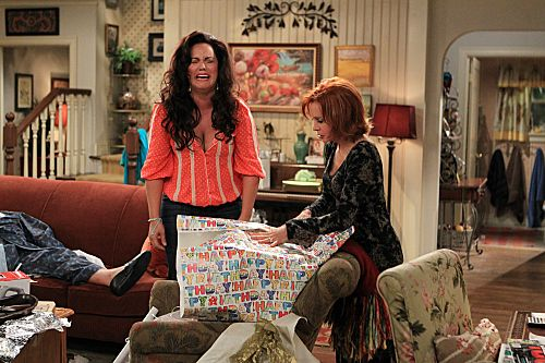 """""""The Honeymoon is Over"""" -- Victoria Flynn (Katy Mixon, left) and Joyce Flynn (Swoosie Kurtz, right) take a sneak peak at Mike & Molly's wedding gifts. Photo: Sonja Flemming/CBS ©2012 CBS Broadcasting Inc. All Rights Reserved."""