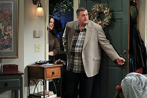 """""""The Honeymoon is Over"""" -- Mike (Billy Gardell) and Molly (Melissa McCarthy) return from their honeymoon in Paris and wonder how their friends and family managed without them. Photo: Sonja Flemming/CBS ©2012 CBS Broadcasting Inc. All Rights Reserved."""