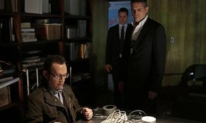 Finch (Michael Emerson, left) uses his tech savvy to help Reese (Jim Caviezel, right)
