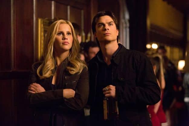 Claire Holt as Rebekah and Ian Somerhalder as Damon