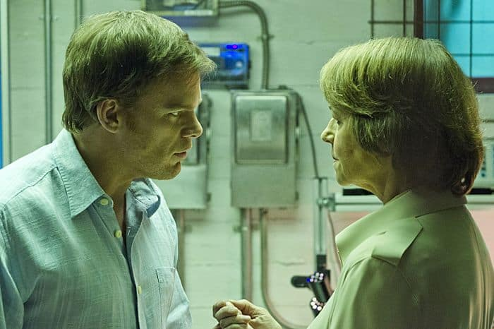 Michael C. Hall as Dexter Morgan and Charlotte Rampling as Dr. Vogel in Dexter