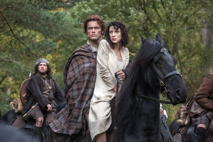 Outlander 2014 Claire Randall (Caitriona Balfe) and Jamie Fraser (Sam Heughan)