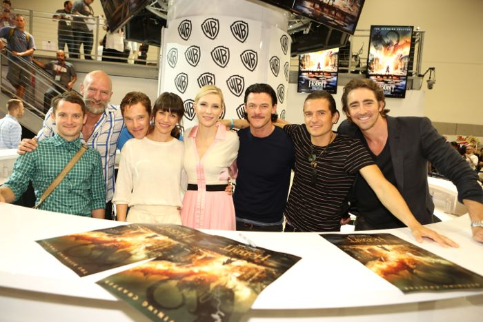 Stars of THE HOBBIT: THE BATTLE OF THE FIVE ARMIES gather for a group shot at the Warner Bros. booth at Comic-Con 2014. From left: Elijah Wood, Graham McTavish, Benedict Cumberbatch, Evangeline Lilly, Cate Blanchett, Luke Evans, Orlando Bloom and Lee Pace