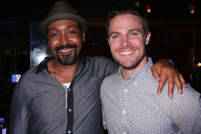 THE FLASH star Jesse L. Martin (left) and ARROW star Stephen Amell hang out during Warner Bros. Television's Comic-Con 2014 cocktail media mixer Friday, July 25, at the Hard Rock Hotel's FLOAT Rooftop Bar