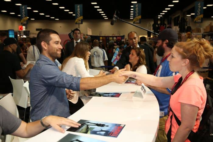 BANSHEE's Antony Starr makes a new friend during the show's signing in the Warner Bros. booth at Comic-Con 2014