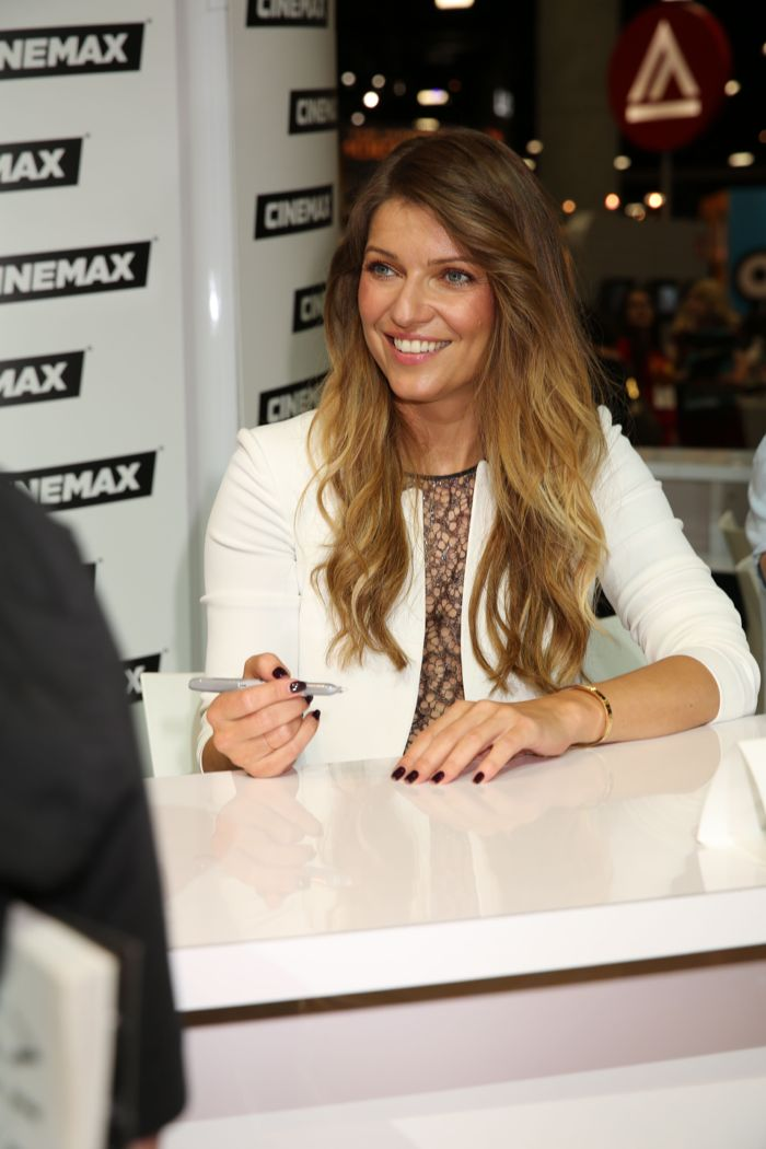 BANSHEE star Ivana Milicevic ready to sign for a fan in the Warner Bros. booth at Comic-Con 2014