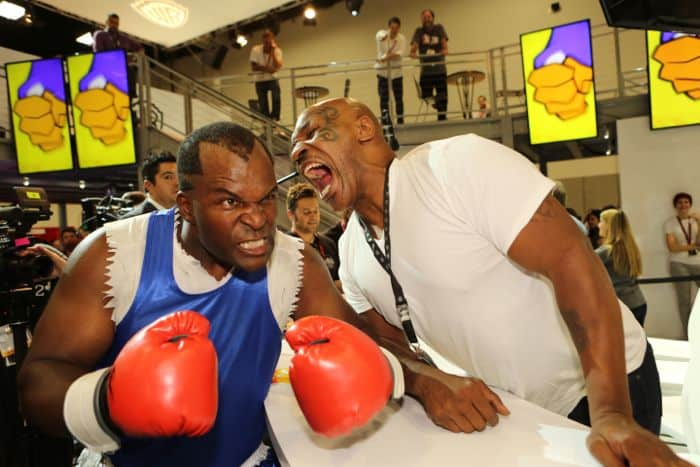 It's all fun and games with Mike Tyson at the Warner Bros. booth during Comic-Con 2014