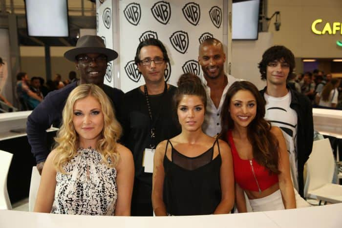THE 100, it's series star Isaiah Washington, executive producer Jason Rothenberg, series stars Ricky Whittle, Devon Bostick, Lindsey Morgan, Marie Avgeropoulos and Eliza Taylor, hanging at the Warner Bros. booth at Comic-Con 2014