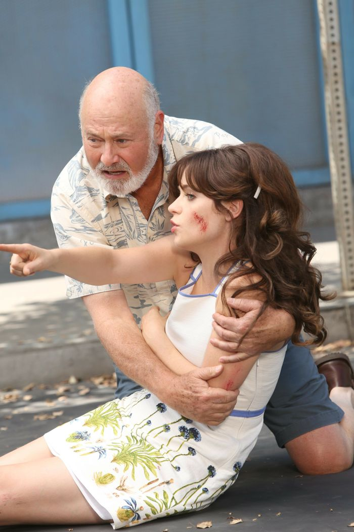 NEW GIRL: After being hit by a cyclist, Jess (Zooey Deschanel, R) gets help from her dad (guest star Rob Reiner, L)