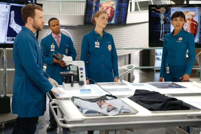 BONES: L-R: Hodgins (TJ Thyne), Dr. Clark Edison (guest star Eugene Byrd), Brennan (Emily Deschanel) and Cam (Tamara Taylor) continue to investigate who framed Booth for murder