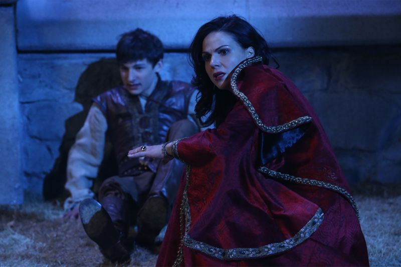"ONCE UPON A TIME - ""Dreamcatcher"" - In Camelot, as Mary Margaret and David attempt to retrieve the Dark One dagger, Emma uses a dreamcatcher to look into the past to see how Merlin was transformed into a tree. Together, Emma and Regina figure out the critical ingredient they must acquire to free Merlin, but it's a race against Arthur, who does not want Merlin released. Meanwhile, with encouragement from his moms, Henry musters up the courage to ask Violet on a date. Back in Storybrooke, the heroes break into Emma's house hoping to locate Gold, but what they find will give them a glimpse of Emma's end game. Far from prying eyes, Merida sets about the mission Emma has tasked her with and begins molding Gold into the hero they need to draw Excalibur, on ""Once Upon a Time,"" SUNDAY, OCTOBER 25 (8:00-9:00 p.m., ET) on the ABC Television Network. (ABC/Jack Rowand) JARED GILMORE, LANA PARRILLA"