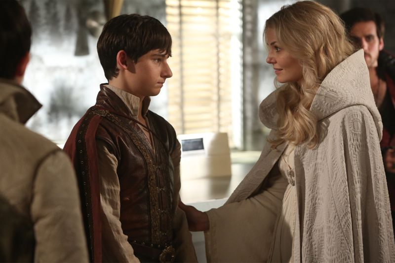 "ONCE UPON A TIME - ""Dreamcatcher"" - In Camelot, as Mary Margaret and David attempt to retrieve the Dark One dagger, Emma uses a dreamcatcher to look into the past to see how Merlin was transformed into a tree. Together, Emma and Regina figure out the critical ingredient they must acquire to free Merlin, but it's a race against Arthur, who does not want Merlin released. Meanwhile, with encouragement from his moms, Henry musters up the courage to ask Violet on a date. Back in Storybrooke, the heroes break into Emma's house hoping to locate Gold, but what they find will give them a glimpse of Emma's end game. Far from prying eyes, Merida sets about the mission Emma has tasked her with and begins molding Gold into the hero they need to draw Excalibur, on ""Once Upon a Time,"" SUNDAY, OCTOBER 25 (8:00-9:00 p.m., ET) on the ABC Television Network. (ABC/Jack Rowand) JARED GILMORE, JENNIFER MORRISON"