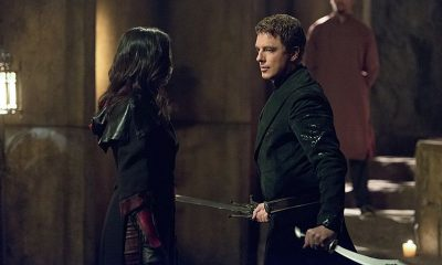 "Arrow -- ""Restoration"" Katrina Law as Nyssa al Ghul and John Barrowman as Malcolm Merlyn -- Photo: Diyah Pera /The CW"