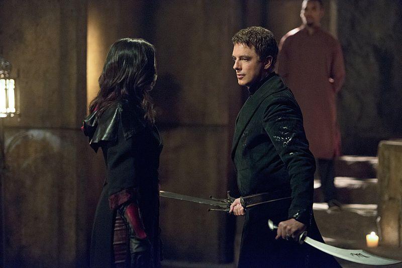 "Arrow -- ""Restoration"" Katrina Law as Nyssa al Ghul and John Barrowman as Malcolm Merlyn -- Photo: Diyah Pera /The CW"